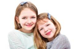 Due ragazze sorridenti sveglie Immagine Stock