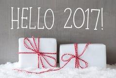 Due regali con neve, testo ciao 2017 Fotografia Stock
