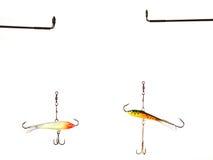 Due richiami della pesca sul ghiaccio dell'equilibrio Immagine Stock Libera da Diritti