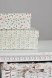 Due scatole sul lato del letto Fotografia Stock Libera da Diritti