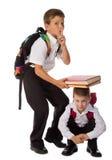 Due scolari che giocano insieme con i libri Fotografia Stock Libera da Diritti