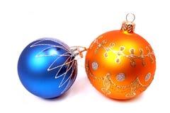 Due sfere celebratorie di colore arancione e blu Fotografie Stock Libere da Diritti