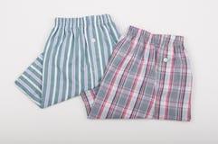 Due shorts della biancheria intima piegati su fondo bianco Fotografia Stock