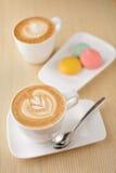 Due tazze del caffè del cappuccino Immagine Stock
