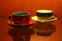 Due tazze di e Fotografie Stock