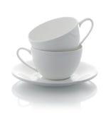 Due tazze e piattini bianchi Fotografie Stock Libere da Diritti