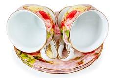 Due tazze e piattini di caffè decorati con i fiori Fotografie Stock Libere da Diritti