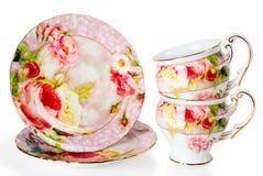Due tazze e piattini di caffè decorati con i fiori Immagini Stock