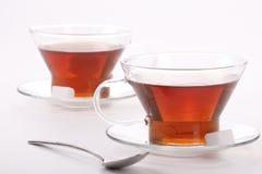 Due tazze eleganti di tè nero Fotografia Stock