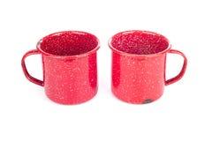 Due tazze rosse del metallo dell'annata fotografie stock
