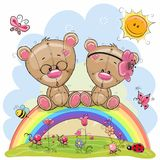 Due Teddy Bears stanno sedendo sull'arcobaleno Fotografia Stock