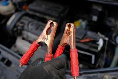 Attempt to start the engine of the car with the sown battery usi. Due to the complexity of the car in winter, the battery is dead and the car does not start. An Royalty Free Stock Photos