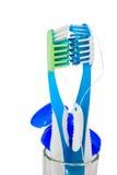 Due toothbrushes e filo per i denti Fotografie Stock Libere da Diritti