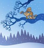 Due uccelli svegli nel paesaggio nevoso Immagine Stock