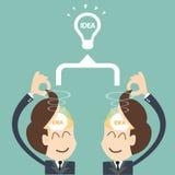 Due uomini d'affari che confrontano le idee lampadina come concetto Immagine Stock Libera da Diritti
