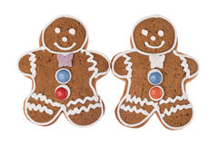 Due uomini di pan di zenzero di Natale isolati su un fondo bianco Immagine Stock Libera da Diritti