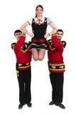Due uomini ed una donna che indossano una posa russa piega del costume Fotografia Stock