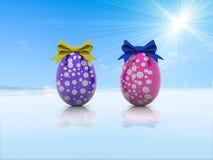 Due uova di Pasqua con gli archi 3d del regalo rendono Immagine Stock Libera da Diritti