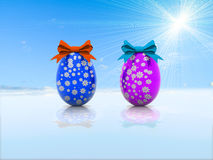 Due uova di Pasqua con gli archi 3d del regalo rendono Fotografia Stock