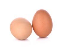 Due uova su priorità bassa bianca Fotografia Stock