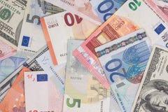 Due valute - dollaro americano e euro Fotografia Stock Libera da Diritti