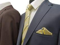 Due vestiti convenzionali su una mostra isolati su bianco Fotografie Stock
