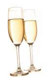 Due vetri del champagne isolati su priorità bassa bianca Immagini Stock