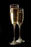 Due vetri del champagne isolati sul nero Fotografia Stock