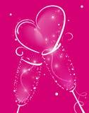 Due vetri di Champagne con la spruzzata astratta del cuore. Immagine Stock