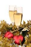 Due vetri di champagne e dell'ornamento di natale Fotografie Stock