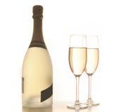 Due vetri e bottiglie del champagne backlit, su bianco Fotografia Stock Libera da Diritti