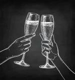 Due vetri tintinnanti delle mani di champagne Fotografie Stock Libere da Diritti