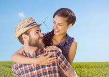 A due vie delle coppie nel campo il giorno di estate Fotografia Stock