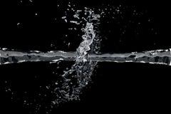 Due waterjet si scontrano su una priorità bassa nera Fotografia Stock Libera da Diritti