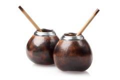 Due zucche a fiaschette con i bombillas isolate su bianco Immagine Stock