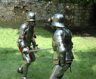 Duel. Between two knights with swords Royalty Free Stock Images