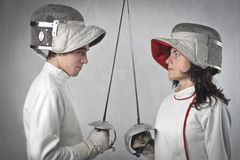 Duel. Couple of fencers facing each other before duelling Royalty Free Stock Images