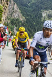 Duel at Alpe D'Huez. Alpe-D'Huez,France- July 18, 2013: The British cyclist Christopher Froome wearing the Yellow Jersey, following Quintana while climbing the Stock Photos