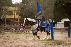 Duel Beginnings. A Knight before the fight does a pass with his flag at the Sherwood Forest Faire in McDade, Texas Royalty Free Stock Photos