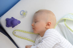 Duel of hypnotic toy and tired baby Royalty Free Stock Photo