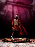 Duel in Rome. Roman centurion  standing close to the corpse of an enemy which he killed, close to a roman monument Royalty Free Stock Images