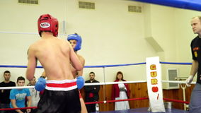 Duel of two athletes in the ring. Mariupol, Ukraine - November 26, 2016: The city championship in kickboxing .Duel of two athletes in the ring. Video was stock video footage