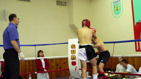 The duel of two athletes in the ring. Mariupol, Ukraine - November 26, 2016: The city championship in kickboxing . The duel of two athletes in the ring. Video stock footage