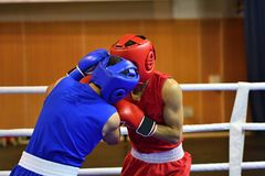 The duel of two boxers. In the boxing ring Royalty Free Stock Photos