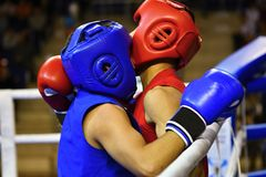 The duel of two boxers. In the boxing ring Royalty Free Stock Images