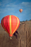 Dueling Balloons. Two Hot Air Balloons racing in Red Rock, New Mexico Royalty Free Stock Images