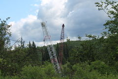 Dueling crane booms Royalty Free Stock Images