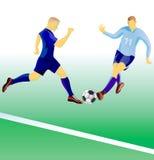 Duelo de los jugadores de fútbol. Foto de archivo libre de regalías