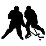Duelo de los jugadores de hockey. Fotografía de archivo