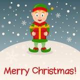 Duende con la tarjeta de la Feliz Navidad del regalo Foto de archivo libre de regalías